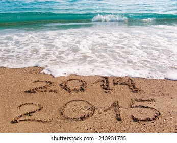 Happy New Year 2015 replace 2014 concept on the sea beach.