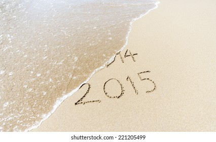Happy New Year 2015 replace 2014 concept on the sea beach
