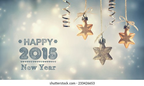 Happy New Year 2015 text with hanging star ornaments