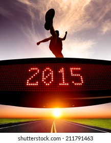 happy new year 2015.runner jumping and crossing over matrix display for celebrating 2015