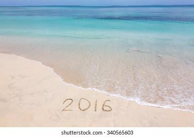 Happy New Year 2016 creative on the beach