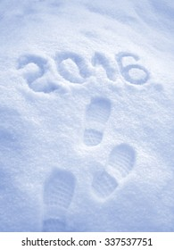Happy New Year 2016 greeting, foot step prints in snow
