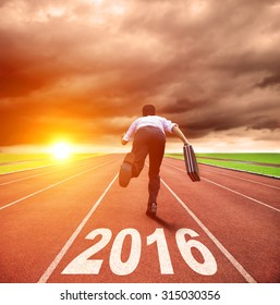 happy new year 2016. young man running with sunrise background