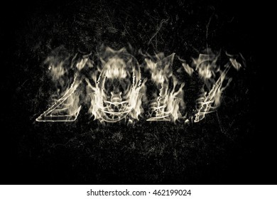 Happy new year 2017 - figures in flame. Collage. Toned.