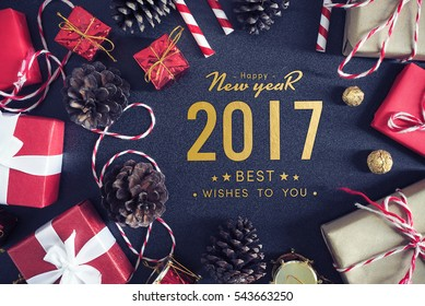 Happy New Year 2017. gift box with white ribbon on red velvet background. over light