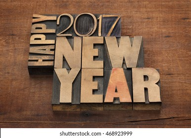 Happy New Year 2017 greeting card - text in vintage letterpress wood type blocks on a grunge wooden background