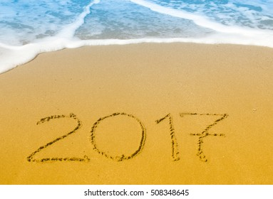 Happy New Year 2017 on the sea beach