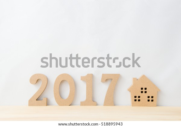 Happy New Year 2017 on a white background,On the right there is a house model