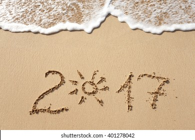 Happy New Year 2017 replace 2016 text on the sea beach
