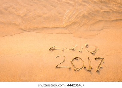 Happy New Year 2017 replace 2016 text on the sea beach, New Year is coming concept.