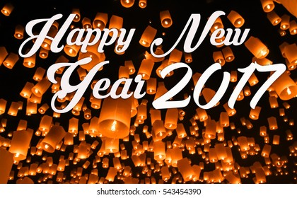 Happy new year 2017 with sky lantern background.