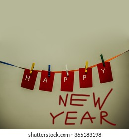 happy new year 2017 word hanging on the Notes paper cards in clothes pegs on rope