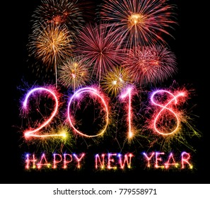 HAPPY NEW YEAR 2018 from colorful sparkle and Fireworks on black background.