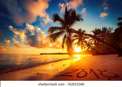 Happy New Year 2018 concept, lettering on the beach. Sea sunrise. Punta Cana