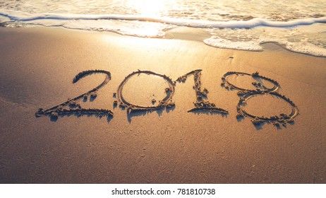 Happy New Year 2018 concept, lettering on the beach with sea sunrise, South Korea.