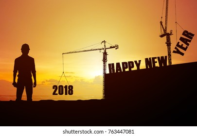 Happy New Year 2018 Engineering Controls Crane is installing the font Happy new year 2018 at sunset effect