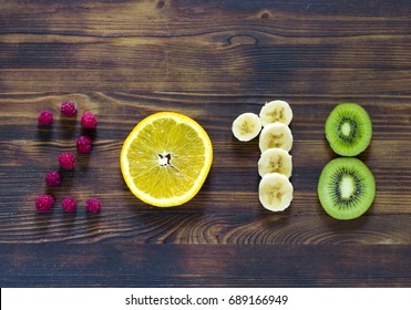 happy new year 2018 of fruit and berries on wooden background