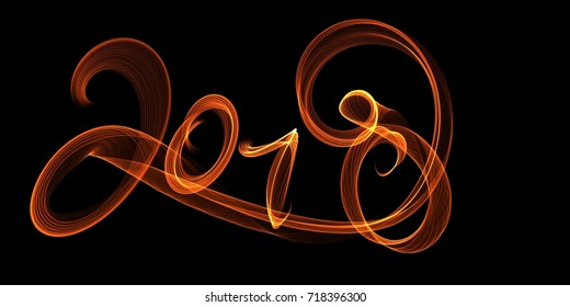 Happy new year 2018 isolated numbers lettering written with fire flame or smoke on black background.