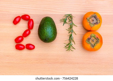 Happy new year 2018 made of vegetables, herbs and fruits on wooden background.