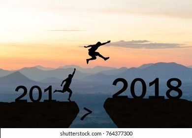 Happy New Year 2018 Men jump over silhouette