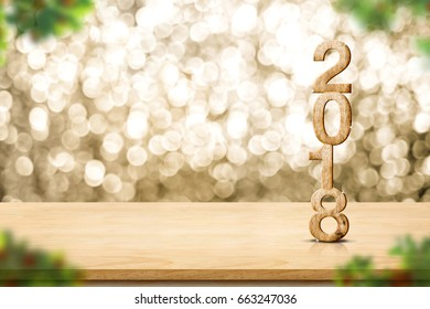 Happy new year 2018 on wood table and blur Christmas tree foreground at blur sparkling gold bokeh light wall,panoramic banner for display or montage of product,holiday seasonal.