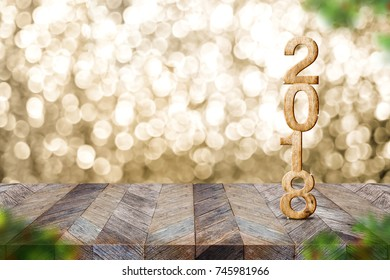 Happy new year 2018 on wood table and blur Christmas tree foreground at blur sparkling gold bokeh light wall,panoramic banner for display or montage of product,holiday seasonal