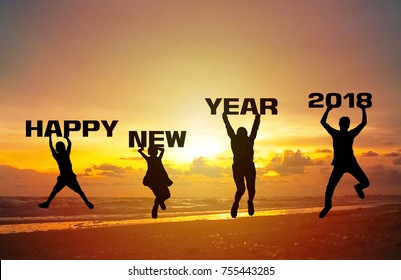 Happy new year 2018 Silhouette family jump lift the  font Happy new year 2018 at sunset time