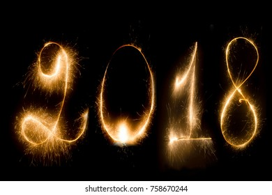 Happy new year 2018 sparkle text on a dark background