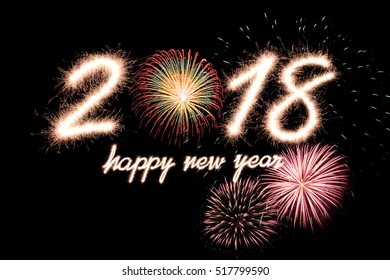 Happy new year 2018 written with Sparkle firework with firework background