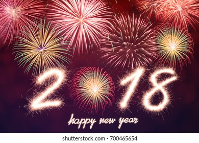 Happy new year 2018 written with Sparkle firework and firework background