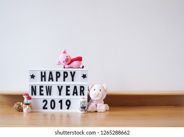 Happy New Year 2019. According to the Chinese animal zodiac, 2019 is a pig year. Copy space on the right to write personal greeting on the wall or place your product on the desk.
