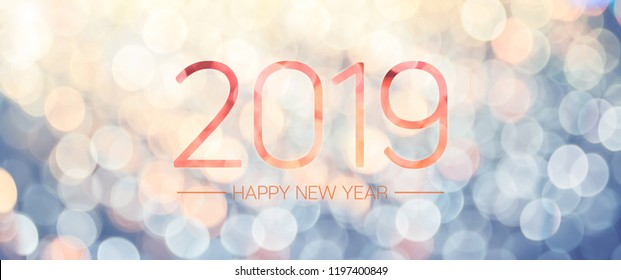 Happy new year 2019 banner with pale yellow and blue bokeh light sparkling background,Holiday greeting card