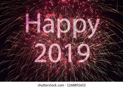 Happy New Year 2019 with colorful sparklers. The words Happy 2019 are integrated into the fireworks on black background