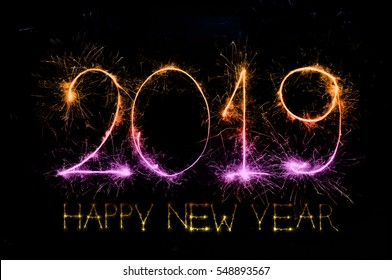 HAPPY NEW YEAR 2019 from colorful sparkle on black background