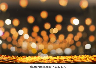 Happy new year 2019 concept: Long exposure of candle light with golden circle bokeh at night background.