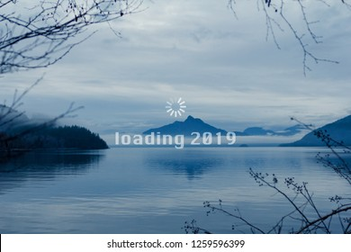 Happy New Year, 2019, geek greetings with mountain and lake canadian landscape and a loading wheel