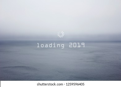 Happy New Year, 2019, geek greetings with grey calm sea landscape and a loading wheel