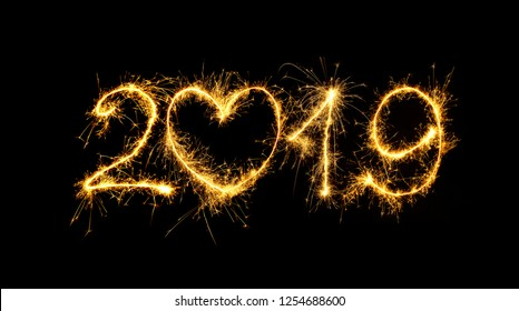 Happy New Year 2019. Number 2019 written sparkling sparklers isolated on black background for design. Beautiful Glowing overlay template for holiday greeting card.