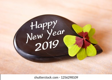 happy new year 2019 on a black stone with cloverleaf