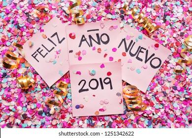 "Happy new year 2019 in spanish ""Feliz año nuevo 2019"" on confetti"