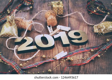 Happy New Year 2019. Symbol from number 2019 on wooden background