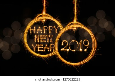 Happy new year 2019 text written with Sparkle fireworks on luxury gold bokeh black background
