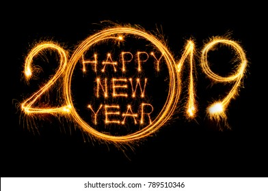 happy new year 2019 text written with sparkle fireworks isolated on black background