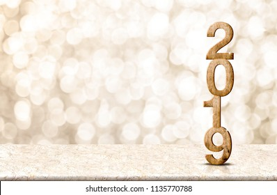 Happy New Year 2019 wood with sparkling star on marble table with gold bokeh background,Holiday festive celebration concept.copy space for display of text or content