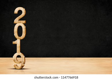 Happy new year 2019 wood number (3d rendering) in perspective wood floor and blackboard wall room,Holiday concept,Leave space for display of product for advertise promotion.Holiday mock up banner