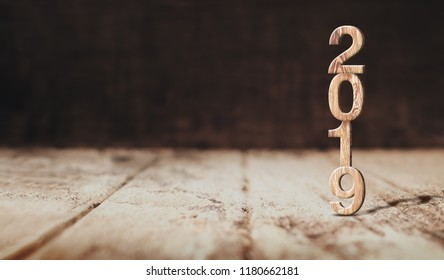 Happy new year 2019 wood (3d rendering) in perspective wood floor and dark wooden wall room,Holiday concept,Leave space for display of product.New year resolutions mock up banner