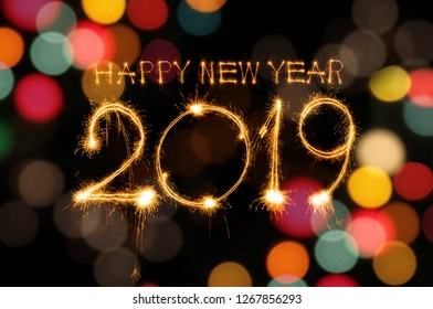 Happy New Year 2019 written with Sparkle firework colourful bokeh background