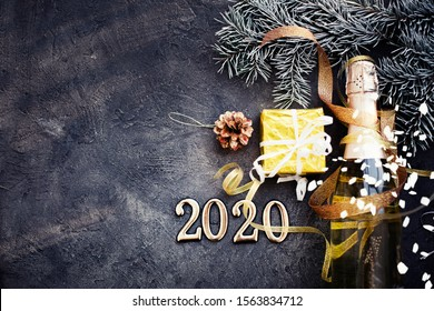 happy new year 2020 background with champagne in dark color with bokeh