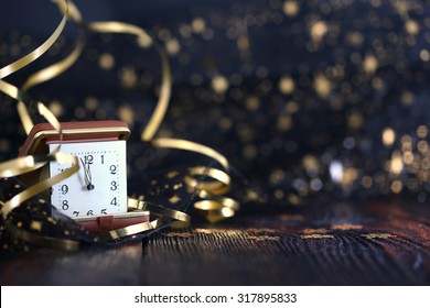 Happy New Year 2020. New year clock on wooden background