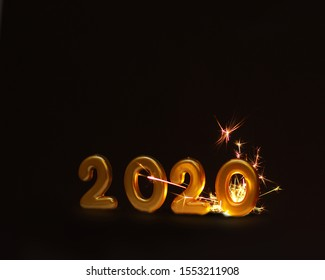 Happy New Year 2020, Golden Number 2020 and Sparkles on Black Isolated